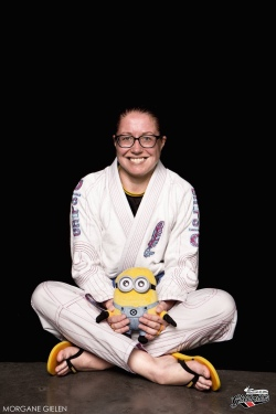 Me sat down holding my dave the minion mascot