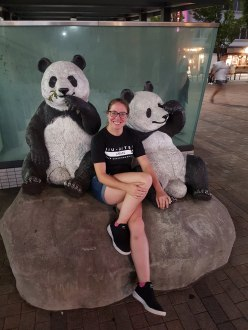 Marie sat with Panda statue