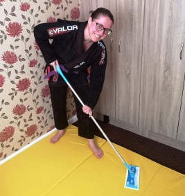 Picture of Minion cleaning the mats wearing a gi