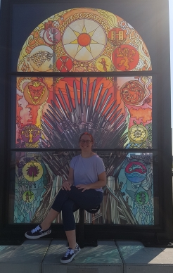 Sat in front of stained glass iron throne